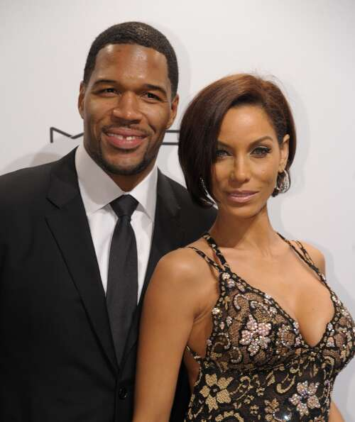 Michael Strahan (L) and  Nicole Murphy (R) arrive at the amfAR (The Foundation for AIDS Research) ga