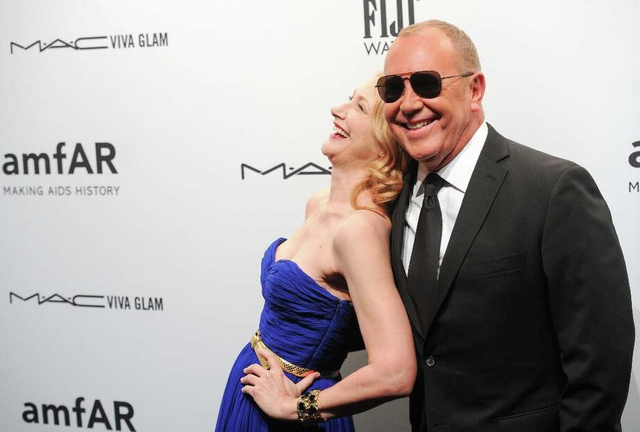 Actress Patricia Clarkson and designer Michael Kors attend amfAR's New York gala at Cipriani Wall Street on Wednesday, Feb. 6, 2013 in New York. (Photo by Evan Agostini/Invision/AP) Photo: Evan Agostini, Associated Press / Invision