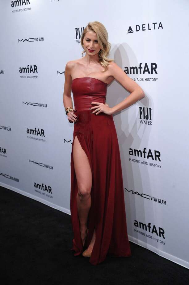 Lena Gercke attends the amfAR New York Gala to kick off Fall 2013 Fashion Week at Cipriani Wall Street on February 6, 2013 in New York City. Photo: Bryan Bedder, Getty Images For FIJI Water / 2013 Getty Images