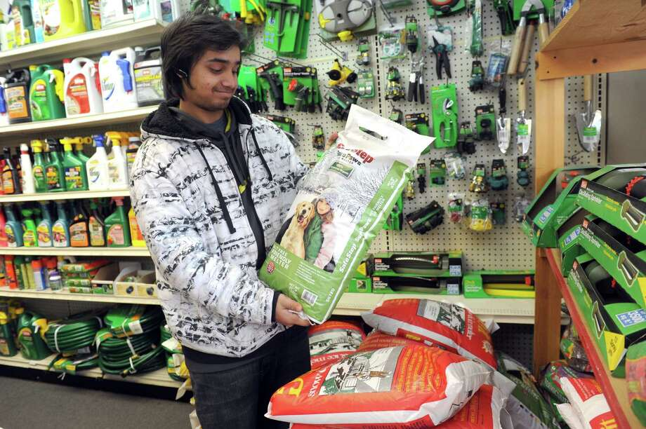 Omar Shakeel of the Cos Cob Hardware, shows the salt that doesn't hurt dogs in 