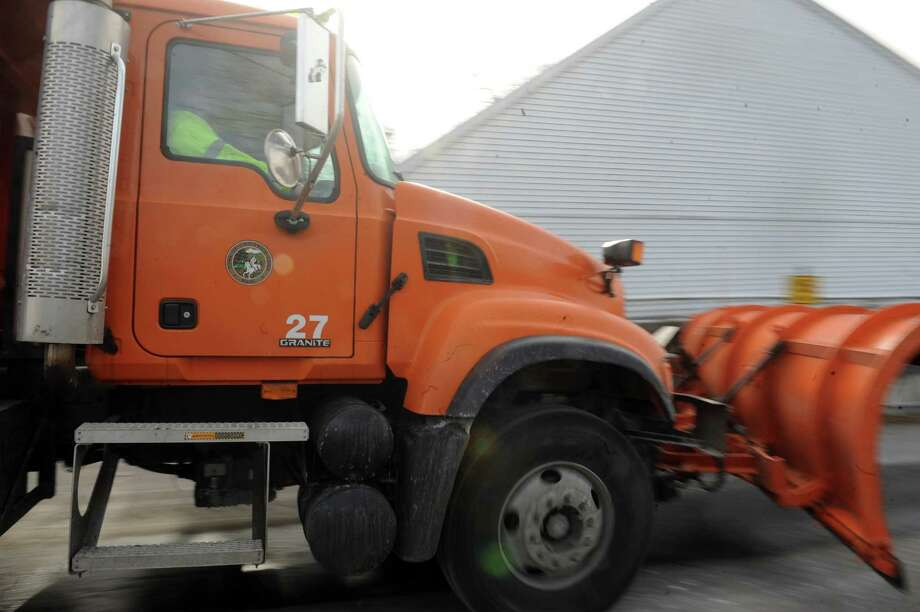A snowplow truck rolls out of John J. Kennedy Fleet Maintenance and Highway Facilitiy in Greenwich, Conn., Thursday, Feb. 7, 2013. Greenwich gets ready for Potential snow storm. Photo: Helen Neafsey / Greenwich Time