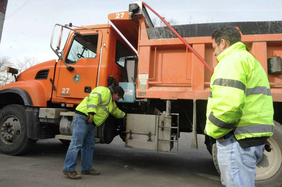 Rich Spezzano left, and Joe Rich, of the DPW, fix a drip in their truck to get ready for potential snow storm  at John J. Kennedy Fleet Maintenance and Highway Facilitiy  in Greenwich, Conn., Thursday, Feb. 7, 2013. Photo: Helen Neafsey / Greenwich Time