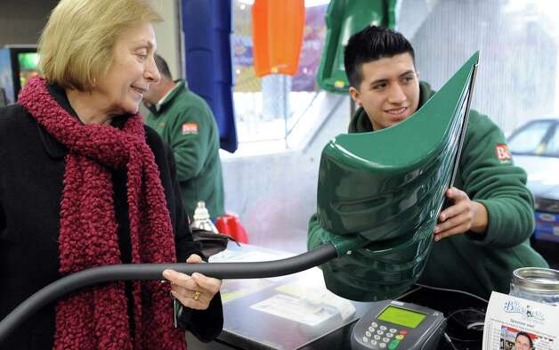 Carole Tierney buys a shovel at Keough's Paint and Hardware in Stamford on Thursday, February 7, 2013, in preparation for winter storm Nemo. Photo: Lindsay Perry / Stamford Advocate