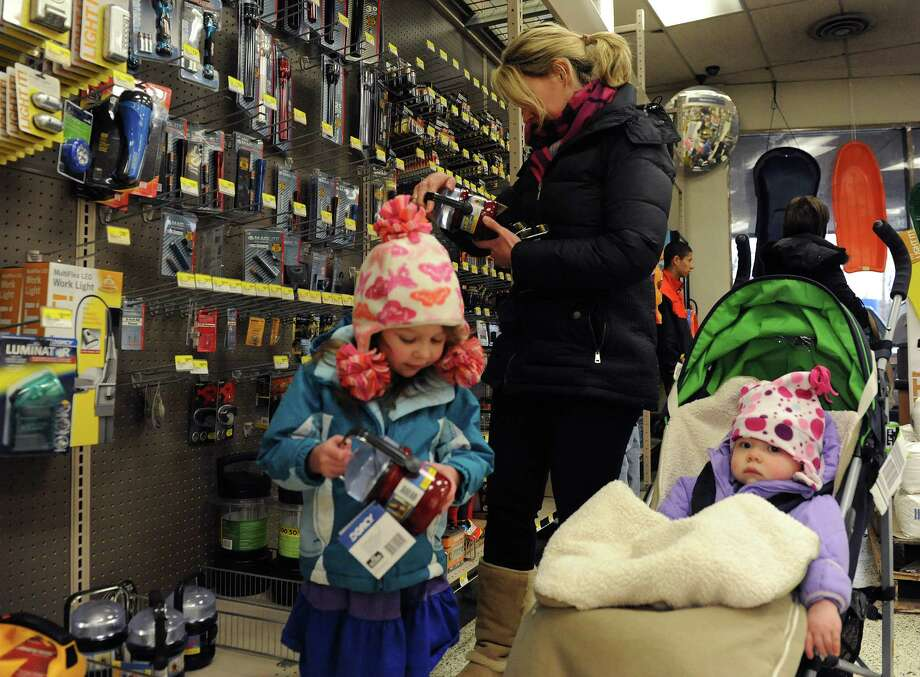 Marie Brennan shops for flashlights with her daughters Kate, 1, and Sophia, 3, at Keough's Paint and Hardware in Stamford on Thursday, February 7, 2013, in preparation for winter storm Nemo. Photo: Lindsay Perry / Stamford Advocate
