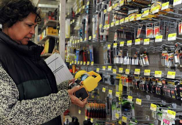 Marcia Kallon shops for a flashlight and batteries at Keough's Paint and Hardware in Stamford on Thursday, February 7, 2013, in preparation for winter storm Nemo. Photo: Lindsay Perry / Stamford Advocate