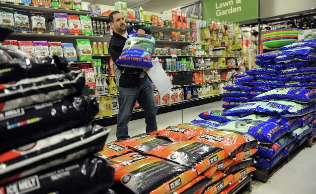 Richard Gioia chooses a bag of snow melt at Karp's True Value in Stamford on Thursday, February 7, 2013, in preparation for winter storm Nemo. Photo: Lindsay Perry / Stamford Advocate