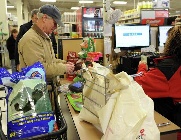 Dick Stinchfield buys snow melt at Karp's True Value in Stamford on Thursday, February 7, 2013, in preparation for winter storm Nemo. Photo: Lindsay Perry / Stamford Advocate
