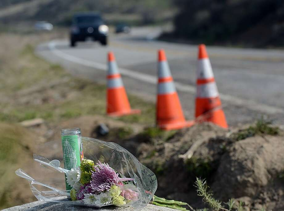 A roadside memorial rests along Highway 38 near Yucaipa, Calif. Wednesday, Feb. 6, 2013.  Fred Bailey Richardson, 72, the driver of a pickup truck struck by a careening tour bus, died Wednesday at a California hospital, bringing the death toll from the mountain road crash to eight. Richardson, who ran a landscaping business, was towing a trailer full of equipment when his truck was struck head-on Sunday evening on Highway 38 near Yucaipa by the bus, which was returning a group to Tijuana, Mexico. (AP Photo/The Sun, Rick Sforza)  VENTURA COUNTY STAR OUT; RIVERSIDE PRESS-ENTERPRISE OUT; THE VICTOR VALLEY DAILY PRESS OUT Photo: Rick Sforza, Associated Press
