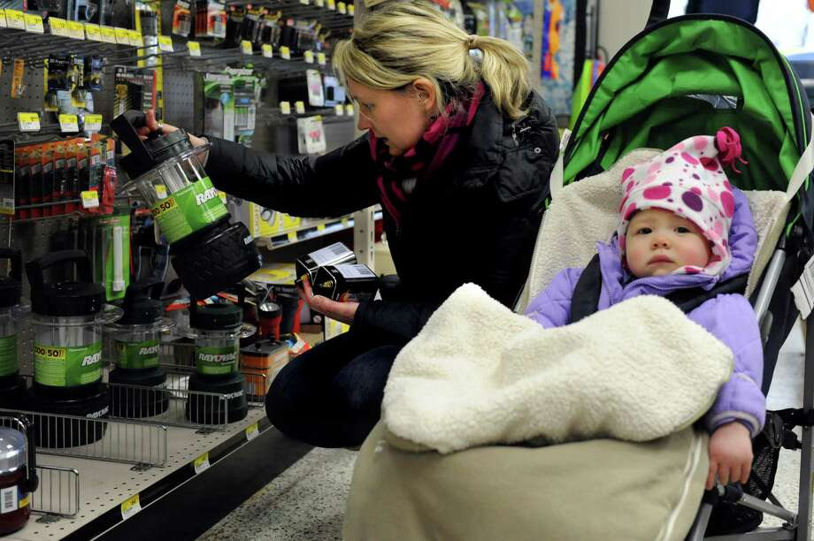 Marie Brennan shops for flashlights with her daughters Kate, 1, right, and Sophia, 3, not pictured, at Keough's Paint and Hardware in Stamford on Thursday, February 7, 2013, in preparation for winter storm Nemo. Photo: Lindsay Perry / Stamford Advocate
