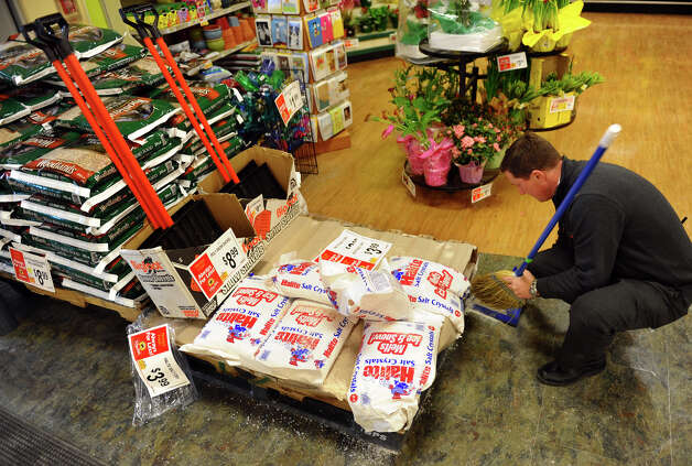 Manager Chris Patrick sweeps up spilled rock salt at ShopRite in Stratford, Conn. on Thursday February 7, 2013. Bags of rock salt, shovels and other winter itmes have been selling as fast as workers can stock them as a major blizzard is forecasted to hit the region. Photo: Christian Abraham / Connecticut Post