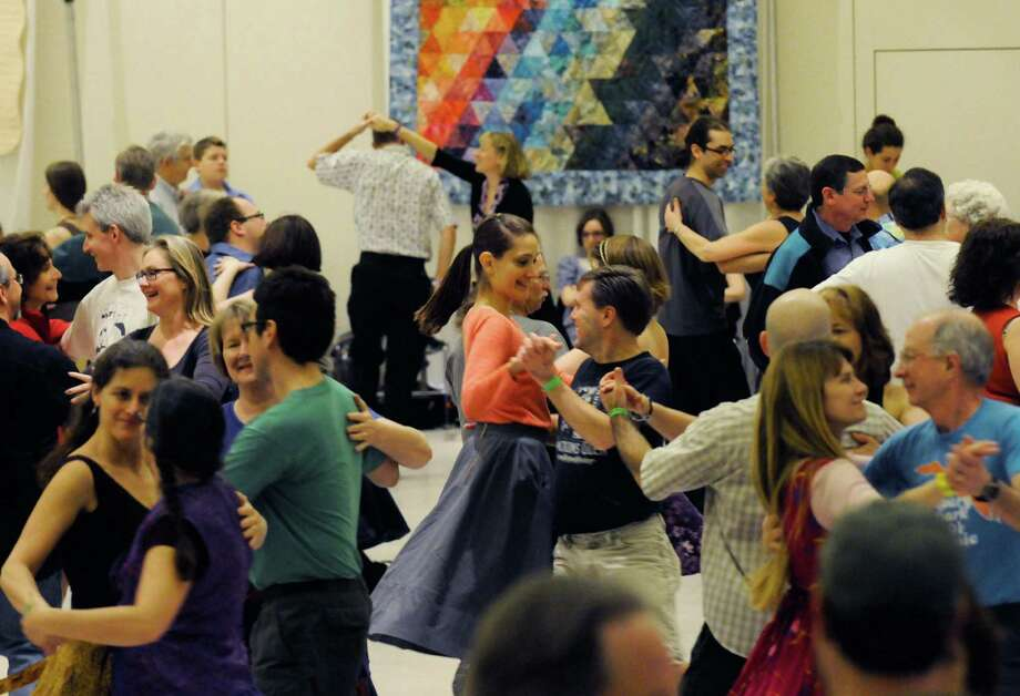 Dancers take part in a swing and contra dance program lead by Susan Petrick and the Fennig's All-Stars as part of Dance Flurry 2012 in Saratoga Springs, N.Y. Saturday Feb.18, 2012. ( Michael P. Farrell/Times Union) Photo: Michael P. Farrell / 00016471A
