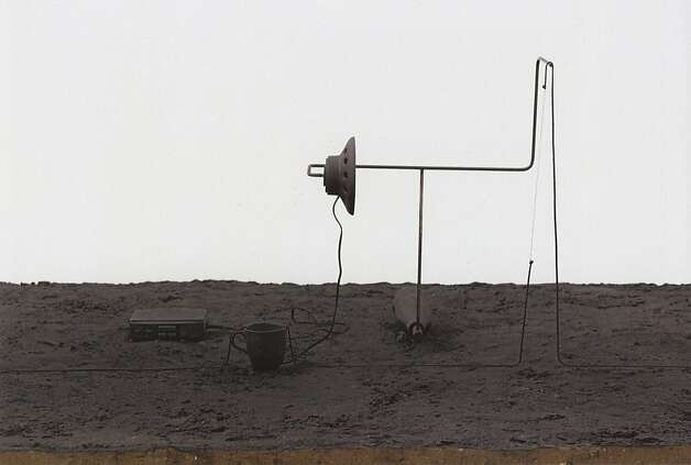 "Mark Manders' ""Reduced Summer Garden Night Scene (Reduced to 88%)"" (2011), sand, painted porcelain, iron, wood and rope, is part of the ""Silence"" exhibition at the Berkeley Art Museum. Photo: Peter Cox"