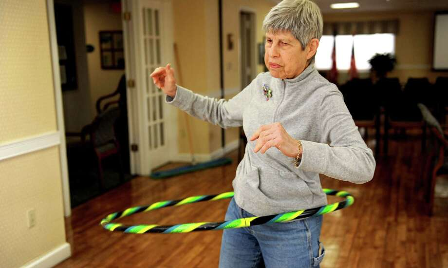 Marian Kasdan hula-hoops at Atria in Stamford on Thursday, December 7, 2013. Photo: Lindsay Perry / Stamford Advocate