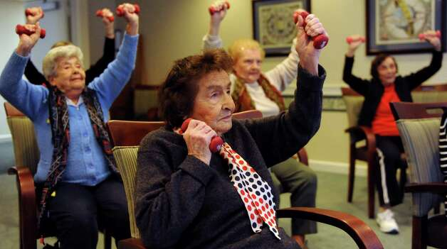 Pearl Soroca, front, participates in an exercise class at Atria in Stamford on Thursday, December 7, 2013. Photo: Lindsay Perry / Stamford Advocate