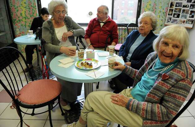 A group gathers in the ice cream shoppe at Atria in Stamford on Thursday, December 7, 2013. Clockwise from left are Eve Hine, Bill Zaccagnino, Liz Gellmann and Peggy Glynn. Photo: Lindsay Perry / Stamford Advocate