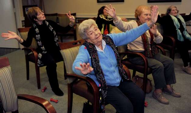 Mary Galgano, front, participates in an exercise class at Atria in Stamford on Thursday, December 7, 2013. Photo: Lindsay Perry / Stamford Advocate