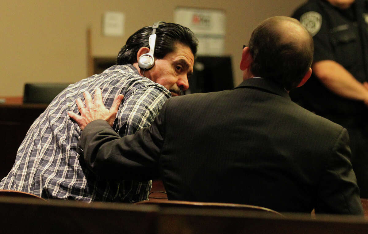 Murder defendant Juan Cavalos (left) receives a pat on the back from defense attorney Scott McCrum after Cavalos was aquitted for the murder of a fellow drifter at the 437th District Court on Thursday, Feb. 7, 2013.