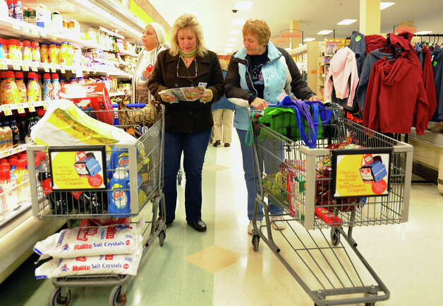 Ahead of a huge blizzard forecasted, Debbie Schmitt, of Long Island, left, came up to help her mom Carol Alex, of Milford, to do some shopping at ShopRite in Stratford, Conn. on Thursday February 7, 2013. Photo: Christian Abraham / Connecticut Post