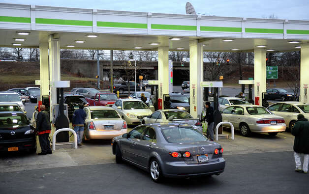 People pack the Cumberland Farms store on West Broad Street to fill up ahead of the huge snow storm expected to hit the area on Friday in Stratford, Conn. on Thursday February 7, 2013. Photo: Christian Abraham