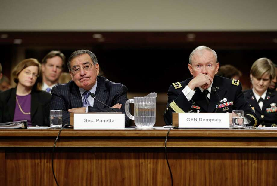 Outgoing Defense Secretary Leon Panetta and Joint Chiefs Chairman Gen. Martin Dempsey confirmed Pentagon support of the plan to arm Syrian rebels. Photo: J. Scott Applewhite, STF / AP