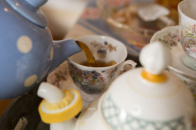 Don't be afraid to use antiques, advises Witte, whose blue polka-dot teapot is one of her many treasures.