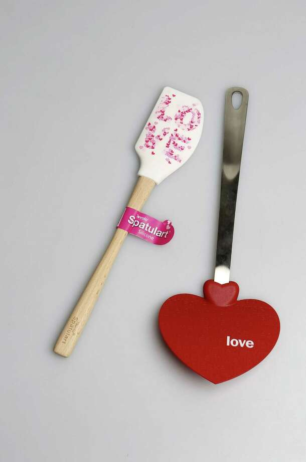 Love silicone spatula and red heart-shaped spatula are available at Dillard's. Photo: Helen L. Montoya / San Antonio Express-News