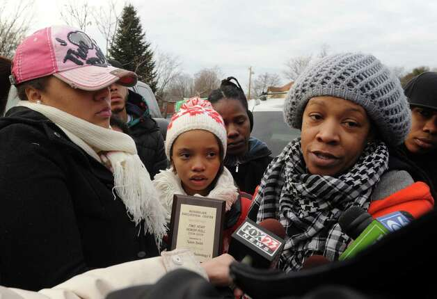 Roshana McArthur, right, the mother of the stabbing victim Takim Smith, talks about the murder of her son during a stop the violence rally and march on Thursday Feb. 7, 2013 in Troy, N.Y. .(Michael P. Farrell/Times Union) Photo: Michael P. Farrell