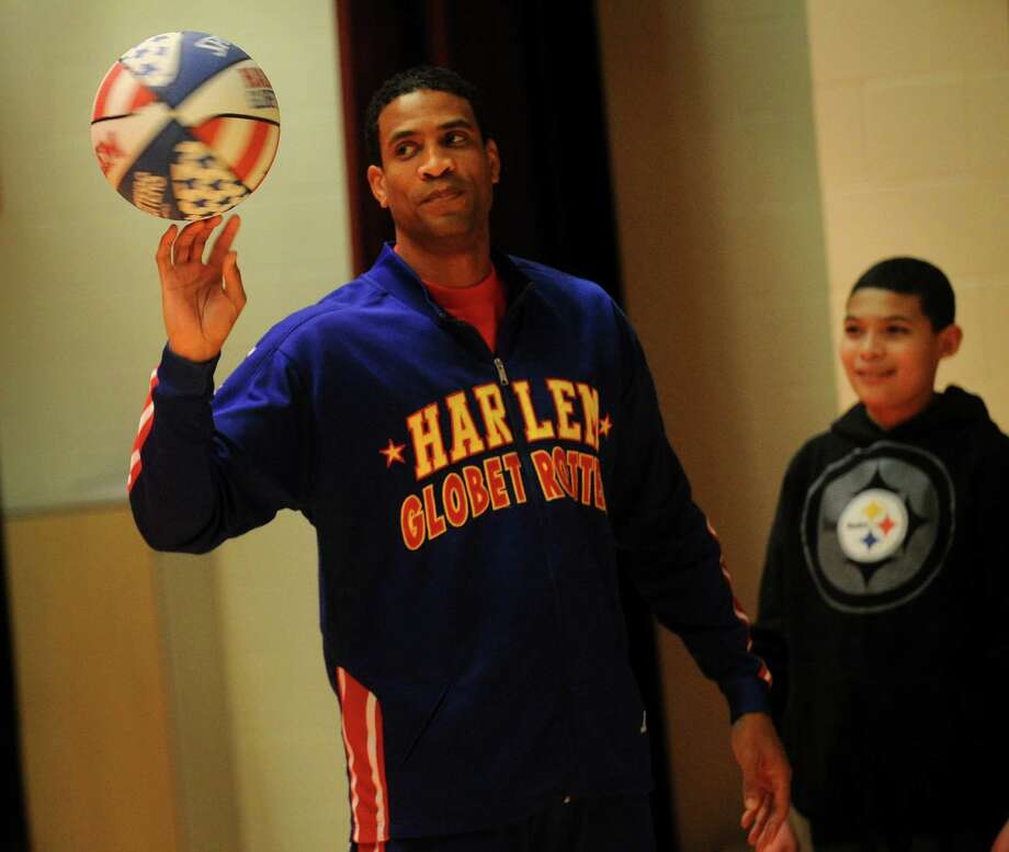 "Harlem Globetrotter Wun ""The Shot"" Versher displays his talents during an assembly at Thurgood Marshall Middle School in Bridgeport on Tuesday, February 5, 2013. The team will be performing at the Webster Bank Arena in Bridgeport on Friday, February 22. Photo: Brian A. Pounds"