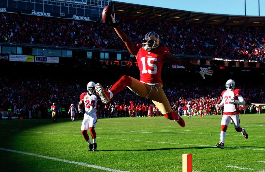 San Francisco 49ers wide receiver Michael Crabtree (15) scores on a 49-yard touchdown reception agai