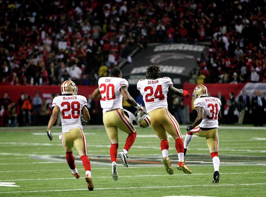 49ers Darcel McBath, (28) Perrish Cox, (20) , Anthony Dixon, (24) and Donte Whitner, (31) celebrate at the end of the game, as the San Francisco 49ers beat the Atlanta Falcons 28-24 to win the NFC Championship game on Sunday Jan. 20,  2013,  at the Georgia Dome in Atlanta Ga. Photo: Michael Macor, The Chronicle / ONLINE_YES