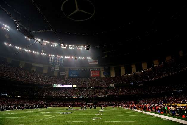 Half the lights go out in the third quarter of Superbowl XLVII between the San Francisco 49ers and the Baltimore Ravens at the Mercedes-Benz Superdome on Sunday February 3, 2013 in New Orleans, La. Photo: Carlos Avila Gonzalez, The Chronicle / ONLINE_YES