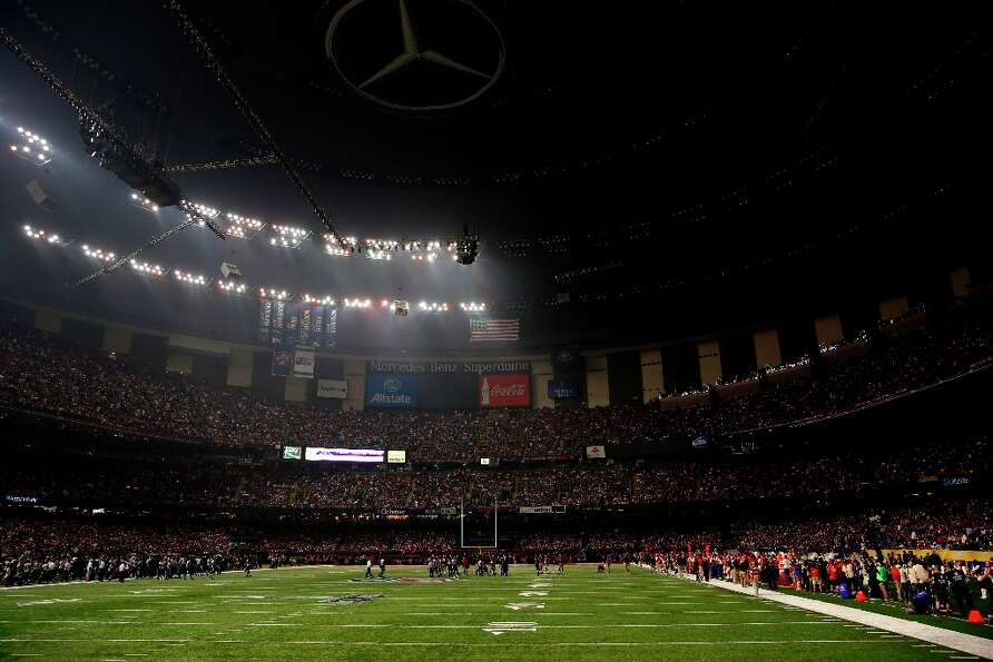 Half the lights go out in the third quarter of Superbowl XLVII between the San Francisco 49ers and t