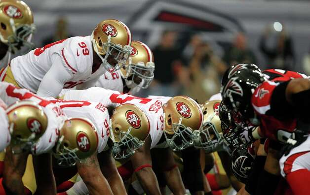 Linebacker Aldon Smith (99) and the defensive line during the first quarter of the San Francisco 49ers game against the Atlanta Falcons in the NFC Championship game at the Georgia Dome in Atlanta, GA., on Sunday January 20, 2013. Photo: Michael Macor, The Chronicle / ONLINE_YES