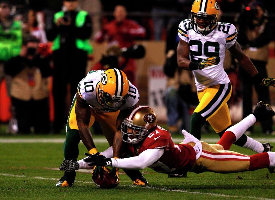 Safety C.J. Spillman recovers a fumble by Jeremy Ross  during the second quarter of the San Francisco 49ers game against the Green Bay Packers in the NFC Divisional Playoffs at Candlestick Park in San Francisco, Calif., on Saturday January 12, 2013. Photo: Carlos Avila Gonzalez, The Chronicle / ONLINE_YES