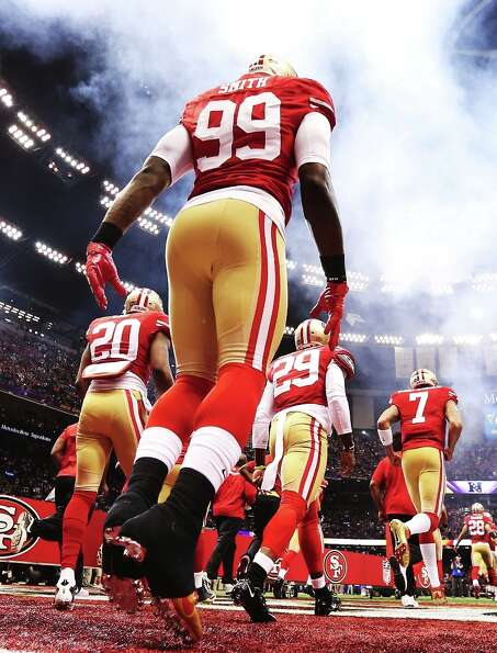 Aldon Smith of the San Francisco 49ers takes the field against the Baltimore Ravens during Super Bow