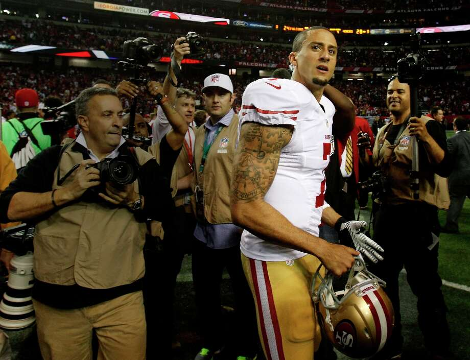 Colin Kaepernick was mobbed by photographers after the contest. The San Francisco 49ers beat the Atlanta Falcons 28-24 to win the NFC title and advance to the Super Bowl Sunday January 20, 2013. Photo: Brant Ward, The Chronicle / ONLINE_YES