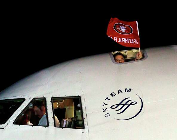 A flag is seen outside the plane carrying the San Francisco 49ers as they arrive at the Louis Armstrong International Airport for the NFL Super Bowl XLVII football game Sunday, Jan. 27, 2013, in New Orleans. Photo: David J. Phillip, Associated Press / AP