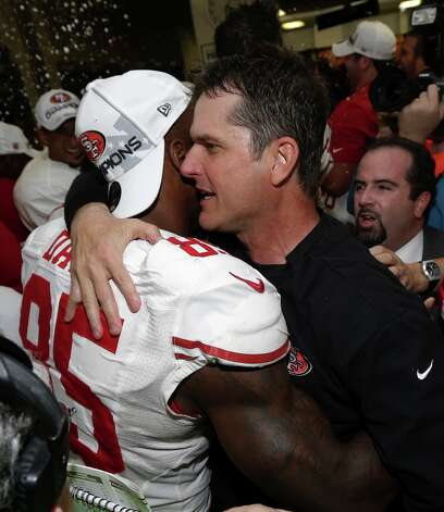 San Francisco 49ers head coach Jim Harbaugh hugs Vernon Davis after the NFL football NFC Championship game against the Atlanta Falcons Sunday, Jan. 20, 2013, in Atlanta. The 49ers won 28-24 to advance to Super Bowl XLVII. Photo: Dave Martin, Associated Press / AP