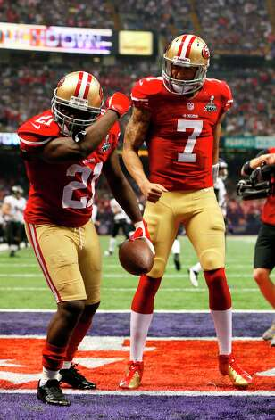 San Francisco 49ers running back Frank Gore Kaepernicks while celebrating with Quarterback Colin Kaepernick (7) after running in a touchdown in the third quarter of Superbowl XLVII between the San Francisco 49ers and the Baltimore Ravens at the Mercedes-Benz Superdome on Sunday February 3, 2013 in New Orleans, La. Photo: Michael Macor, The Chronicle / SFC