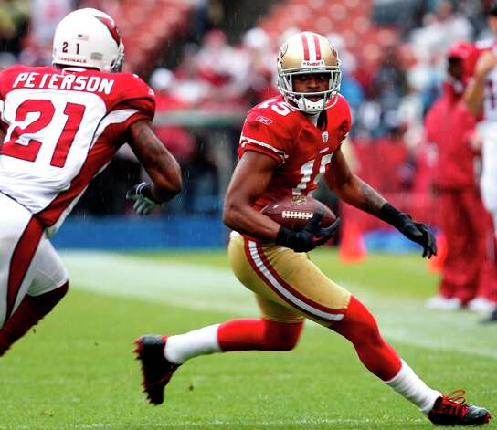 San Francisco 49ers Michael Crabtree makes a first down in the first half against , Sunday November 20, 2011, at Candlestick Park in San Francisco, Calif. Photo: Lacy Atkins, The Chronicle / ONLINE_YES