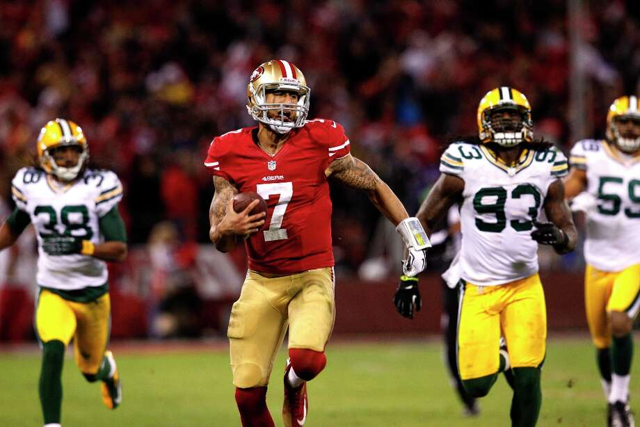 Colin Kaepernick runs in for a touchdown in the third quarter of the San Francisco 49ers game against the Green Bay Packers in the NFC Divisional Playoffs at Candlestick Park in San Francisco, Calif., on Saturday January 12, 2013. Photo: Brant Ward, The Chronicle / ONLINE_YES