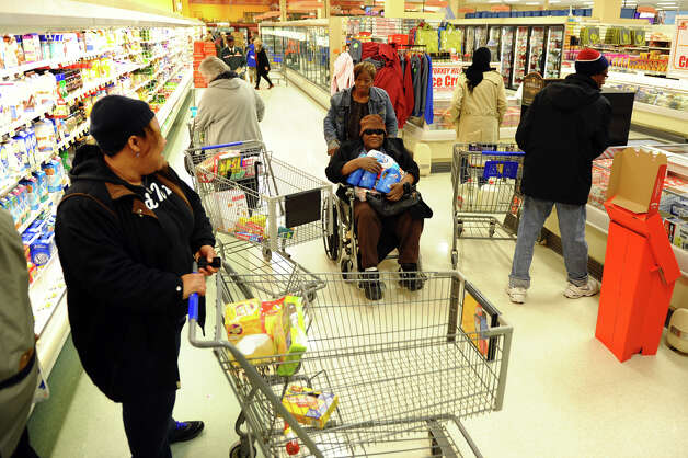 Dozens of customers stock up ahead of the forecasted blizzard at ShopRite in Stratford, Conn. on Thursday February 7, 2013. Photo: Christian Abraham / Connecticut Post