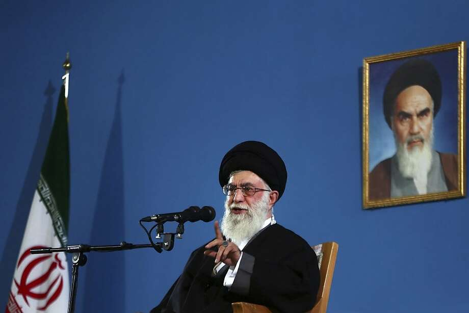 In this photo released by an official website of the Iranian supreme leader's office, supreme leader Ayatollah Ali Khamenei, gives a speech to a group of air force members, in Tehran, Iran, Thursday, Feb. 7, 2013. Iran's supreme leader Thursday strongly rejected proposals for direct talks with the United States, effectively quashing suggestions for a breakthrough one-on-one dialogue on the nuclear standoff and potentially other issues. A portrait of the late revolutionary founder Ayatollah Khomeini, hangs on the wall. (AP Photo/Office of the Supreme Leader) Photo: Associated Press
