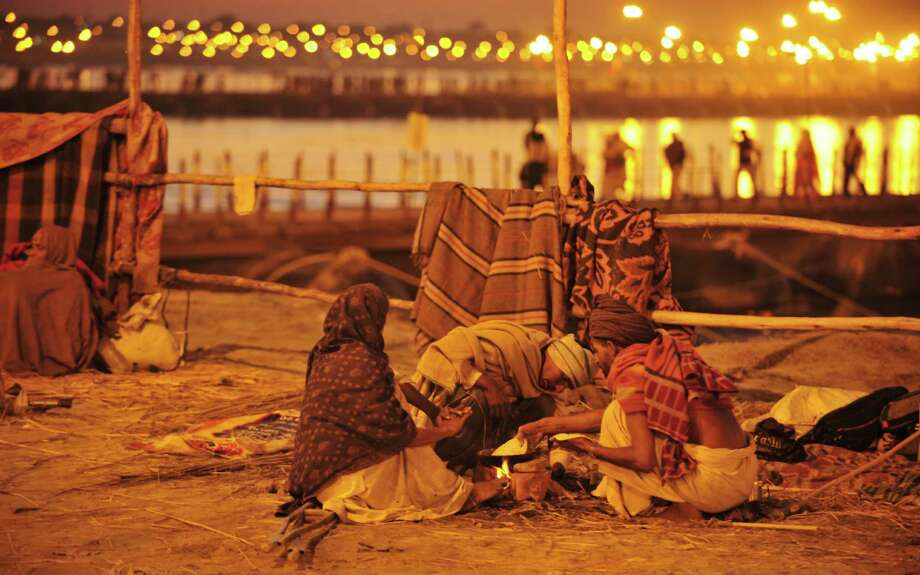 Indian devotees prepare food on the banks of river Ganga during the Maha Kumbh festival in Allahabad on February 7, 2013. Photo: SANJAY KANOJIA, AFP/Getty Images / AFP