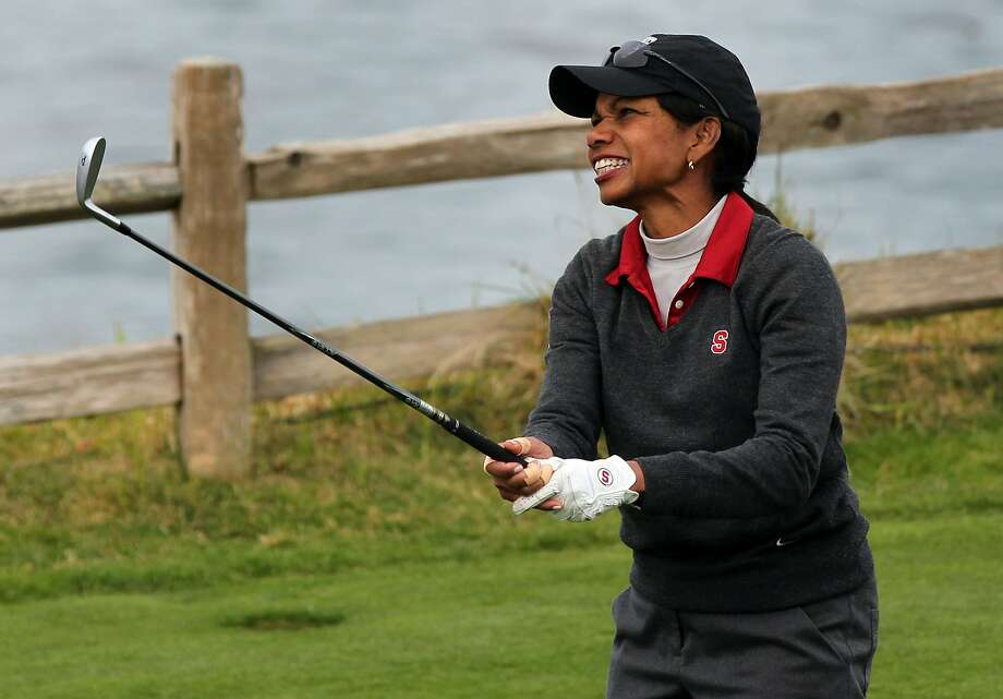 Condoleezza Rice reacts to her drive onto the par three 7th hole at Pebble Beach Golf Links during opening rounds of the AT&T Pebble Beach Pro-Am golf tournament on Thursday, Feb. 7th, 2013, in Pebble Beach, Calif. Photo: Lance Iversen, The Chronicle