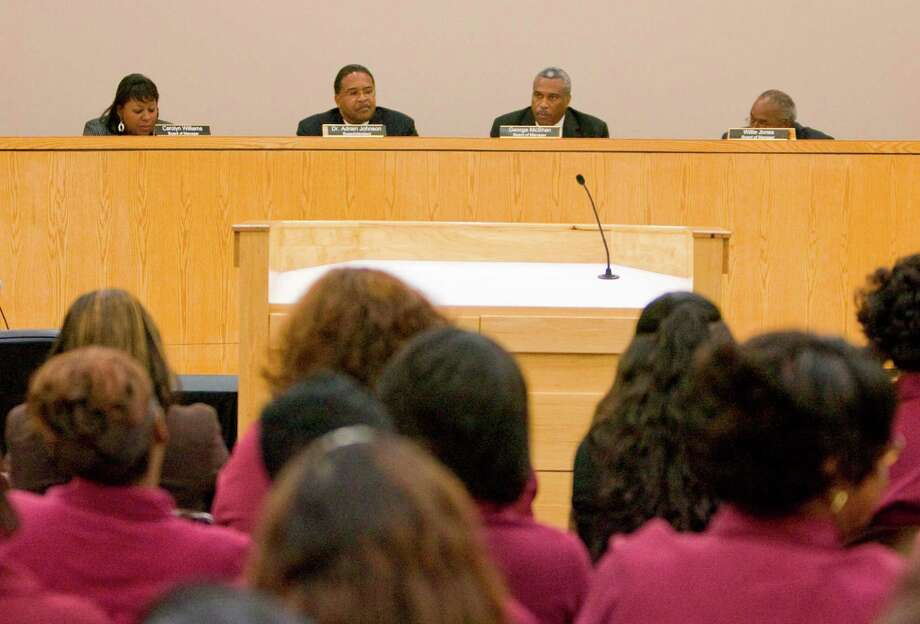 March 2011: The board votes to put Superintendent Adrian Johnson, second from left, appointed by the TEA, on administrative leave. Photo: Steve Campbell, Houston Chronicle / Houston Chronicle