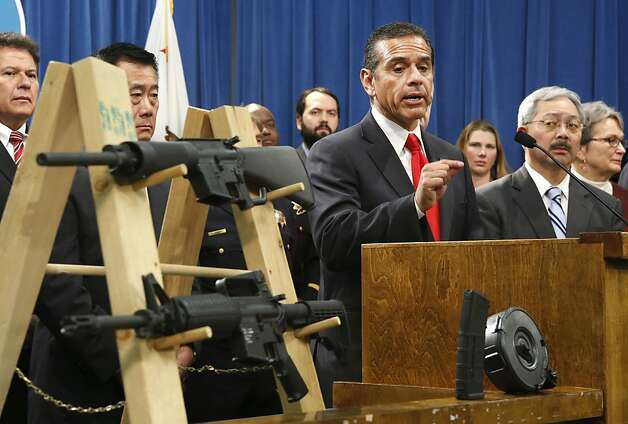 Los Angeles Mayor Antonio Villaraigosa is flanked by state Sen. Leland Yee, D-San Francisco (second from left), and San Francisco Mayor Ed Lee as he discusses public officials' support for legislative ideas to restrict guns and ammunition in California. Photo: Rich Pedroncelli, Associated Press