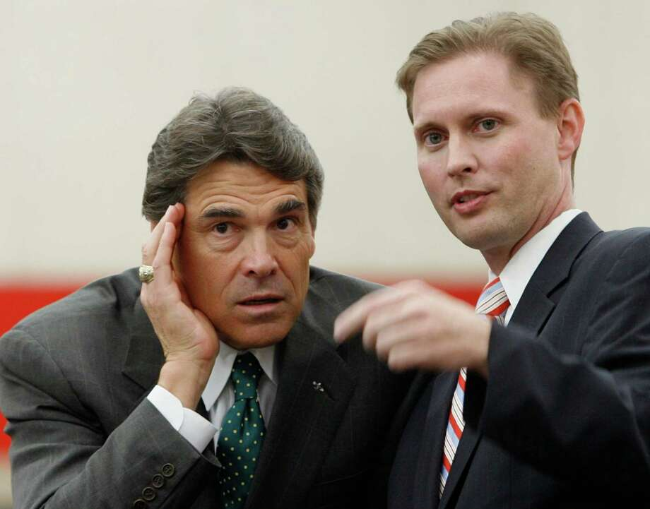 July 12, 2011: Scott, seen here with Gov. Rick Perry, orders closure of North Forest ISD in July 2012, and orders its