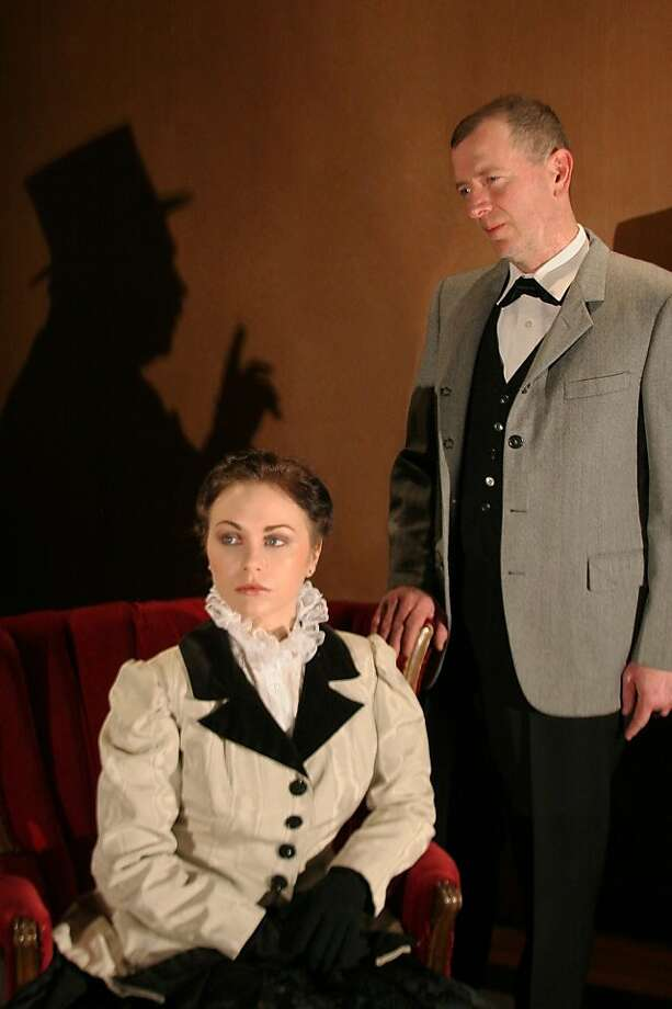 "Craig Dickerson (right) as Sherlock Holmes and Sarah Klaren as Irene Adler in Douglas Morrisson Theatre's ""Sherlock Holmes: The Final Adventure"" Photo: Terry Sullivan"