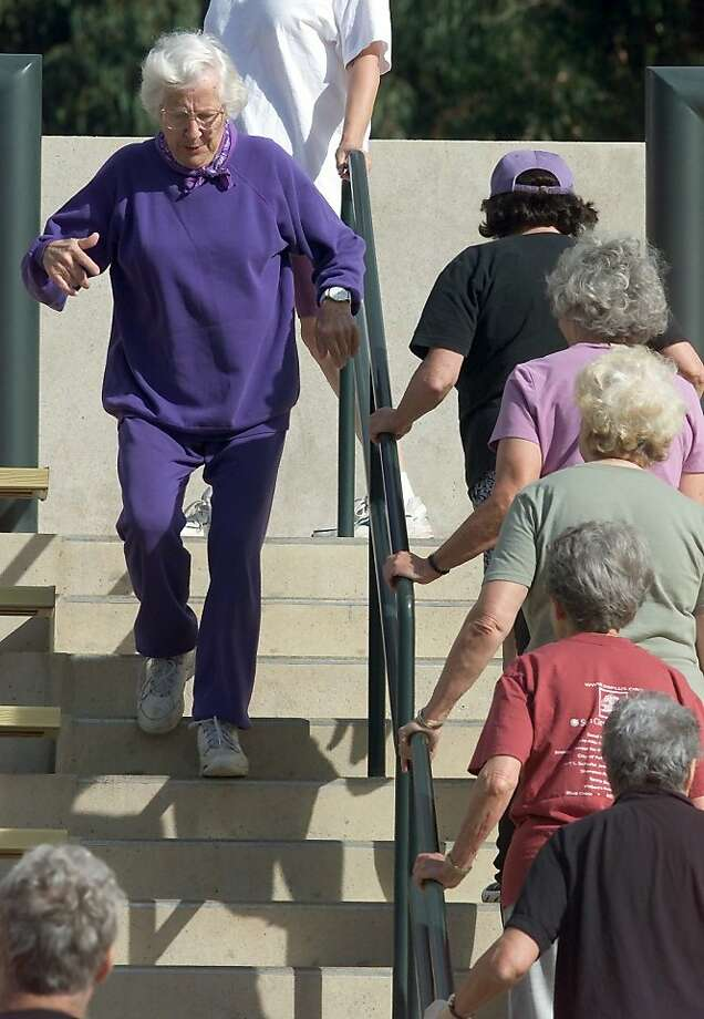 50PLUS6-C-21JUL01-LV-DF Sara Contie, 78, (at left) leads the pace going up and down stairs on this drill.  Fifty-Plus Fitness Challenge Camp is a small group exercise program designed for older adults currently held at Stanford University campus in Palo Alto. CHRONICLE PHOTO BY DEANNE FITZMAURICE Photo: Deanne Fitzmaurice, SFC